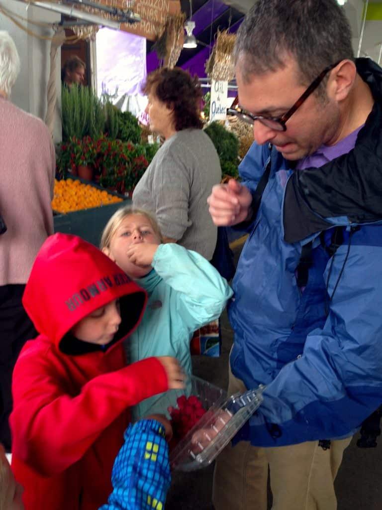 Kids eating fruit at Jean Talon Market, Montreal