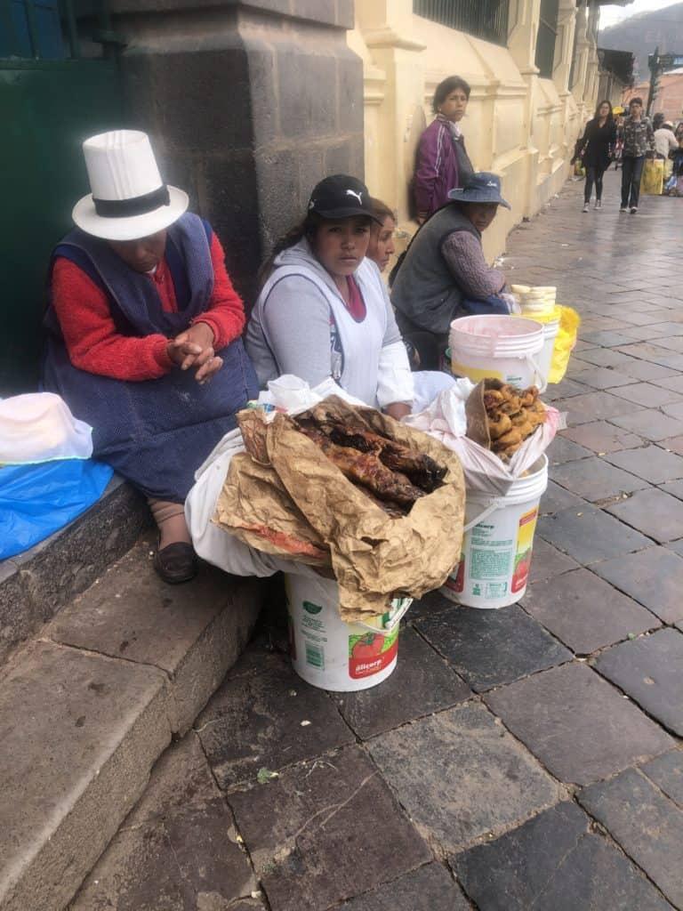 Women selling guinea pig open air market, cusco