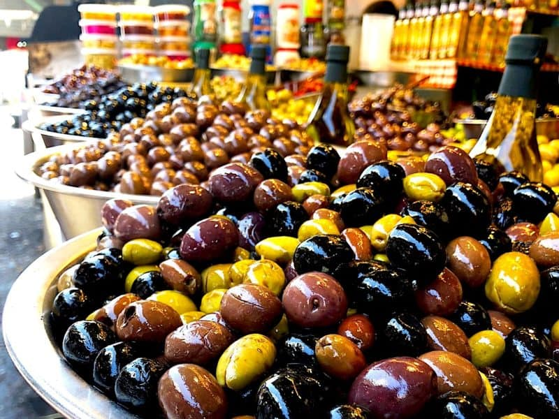Bowls of fresh olives at an open air market