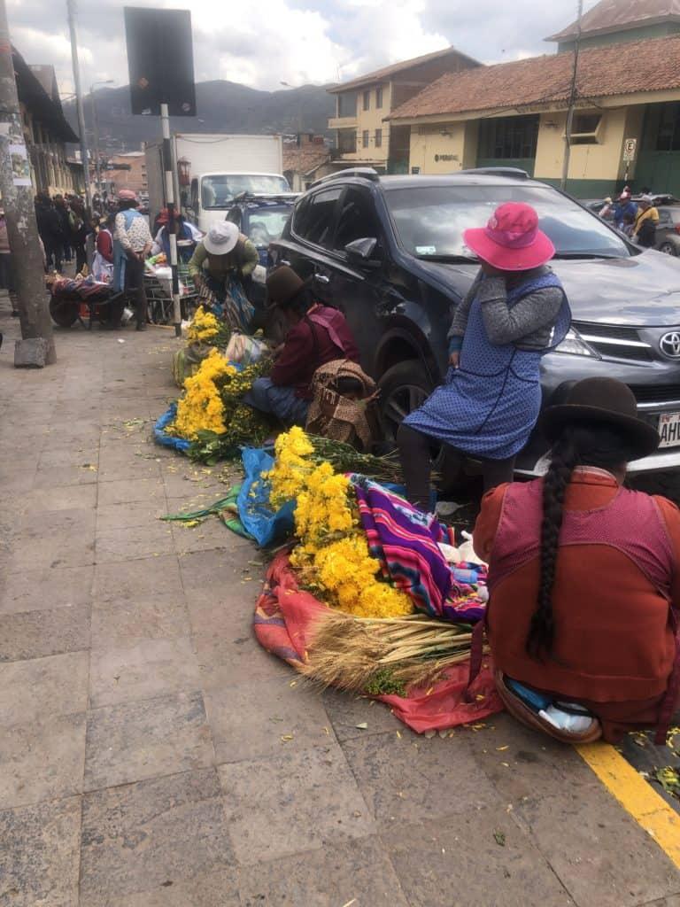 Selling veggies outside open air market, cusco