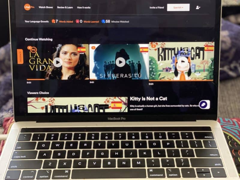 landing page of language learning app displaying tv shows, movies