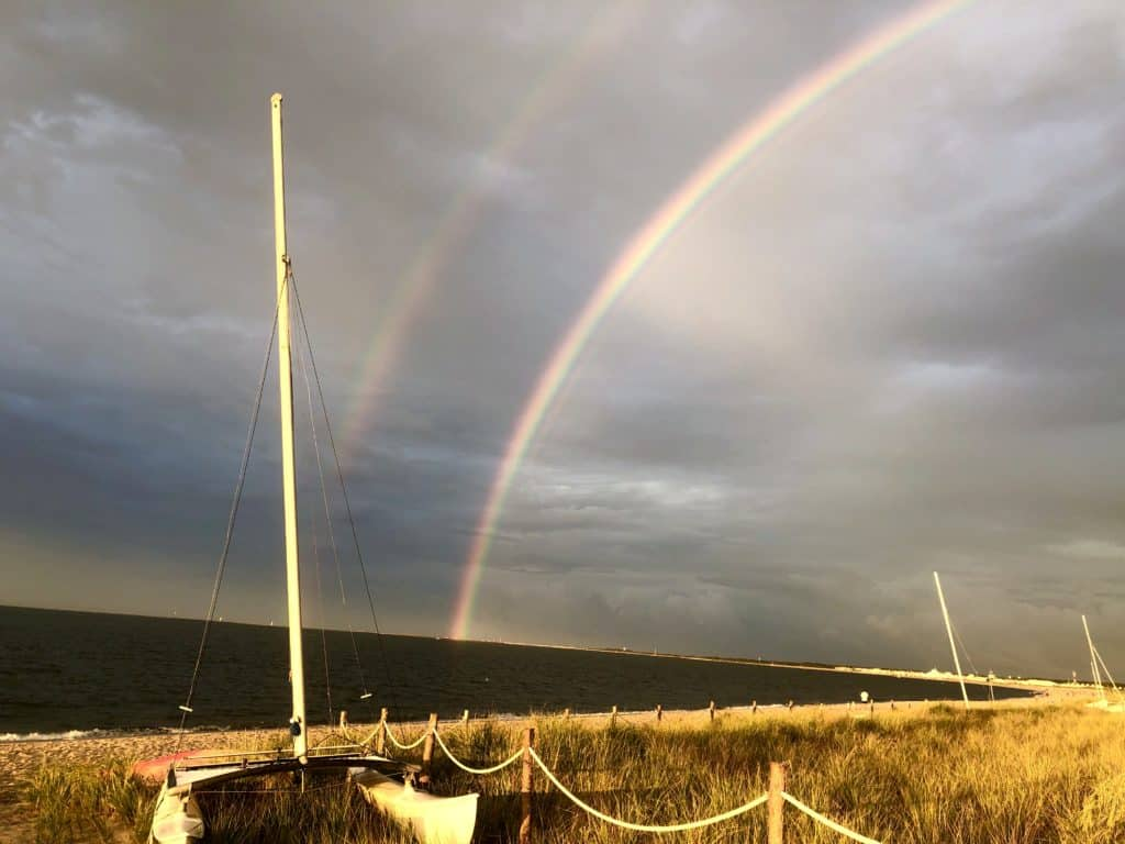double rainbow over beach