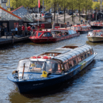 Boat sailing down canal in Amsterdam